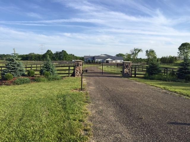 Amazing HOME & EQUESTRIAN TRAINING FACILITY 20 Min from Milwaukee. Carriage House w/ high-end finishes boasts 1820 sq.ft, w/ possibility of property to be subdivided for building of custom home. 8 stall heated barn/tack room/wash stall is attached to fully insulated 72'x184' arena w/ carpet fiber/sand footing & o/h watering system provide for comfortable year round training. At current board/full-training fee @ $2120 per mo., 8 stalls offers the potential of +$203,000.00/year. The indoor arena offers endless possibilities. Multiple turn-outs have several shelters & dry lots connected to acres of established grass pastures. Private retreat, yet 5 minutes from amazing restaurants & shops.  Property is offered at far less than the cost of building & is a MUST SEE. Too many amenities to list.
