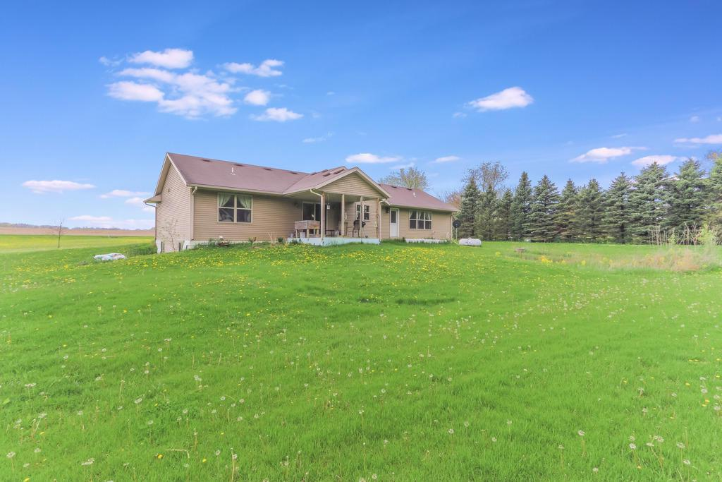 Newer Ranch home on 5.24 acres with sweeping countryside views! Open concept design, cathedral ceilings. Oak HW floors. Large Bay Window. Main floor laundry and separate mud room. Master Suite has large walk-in closet and spacious bath. SS GE appliances and Whirlpool W/D. Central Vac system. Horses allowed. Property goes beyond trees in back. Covered porch can be screened in or made into a 3-season room. NEW shed. LL rec room, 2 bdrms and 3rd stubbed bath are 75% finished. Drywall, electric, HVAC are in place.  Needed is paint and carpet.  Finishing this will add an additional 1760 sq ft of living space and make this a 5 bdrm and 3 bath home! Garage door was replaced with a window and garage is currently being used as a craft room. Framing still in place to put overhead door back in.
