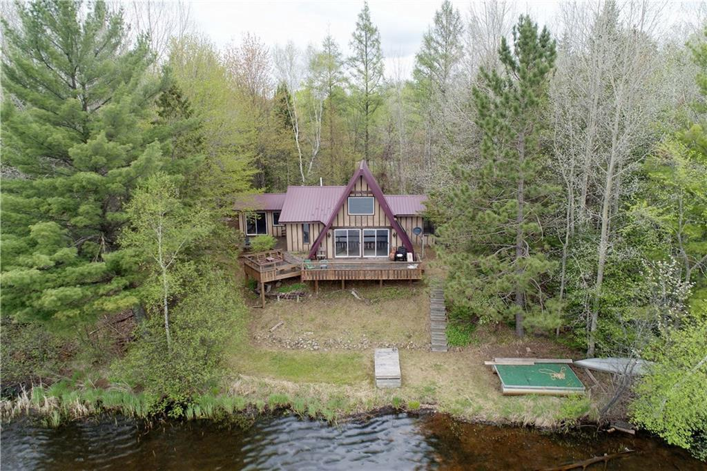 This adorable A-frame is the kind of cabin that brings back nostalgic feelings and fond memories at the lake! Situated on a very private lot with nearly 9 acres of land and not a neighbor in sight. Stunning views from cabin and large deck, which is only 35 feet from the lake. The cabin offers one bedroom on the main level and a spacious loft which is used as a second bedroom. Inviting living room/dining room addition finished with knotty pine and a screened in porch to enjoy the outdoors free from the elements. Black Dan Lake is crystal clear and offers excellent scenery, island views, swimming, and fishing (Walleye, Muskie, Bass, Panfish). Woods & water opportunities like this are far and few in between - don't miss out!