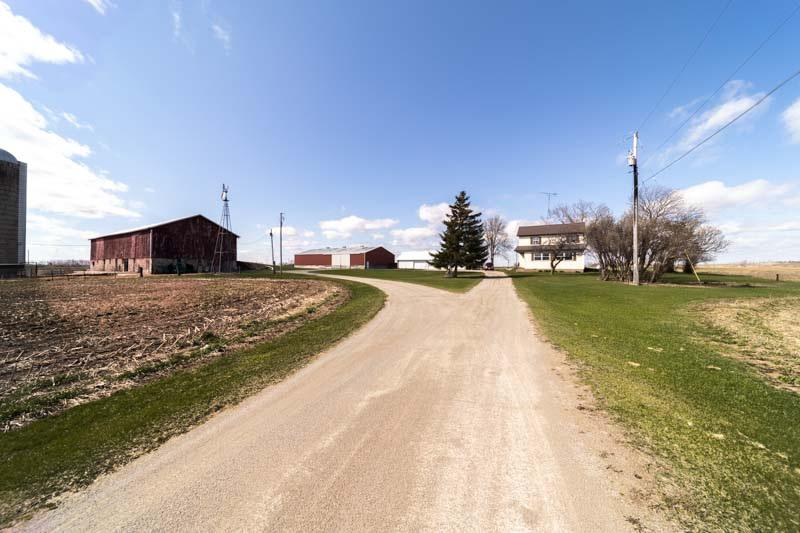 Well maintained 3 bedroom farm on just under 11 acres. (Zoning 8 ag & just under 3 undeveloped). Home features 1 bed on main & 2 up, large LR & dining room as well as a spacious sun room.  Property also offers a large workshop, huge pole shed, & barn.