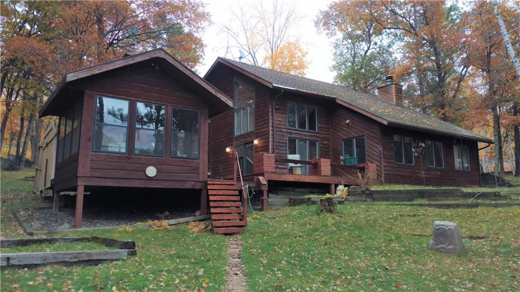 This 3 BR, 2 BA home sits on 300 feet of Robinson Lake--part of the Eau Claire Chain. Well maintained and comfortable. Spacious, bright living spaces with lake views, woodburning fireplace, and generous kitchen with attached laundry. Office space for telecommuting. An extensive deck connects home with a 12x12 3-season gazebo is ideal for loon watching. The clear water and sandy shore complete this perfect home/get-away. A 2 car detached garage provides ample storage. This one will not last long!