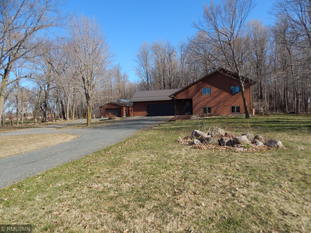 Well cared for, Move in ready on 80 beautiful acres!  This home offers 4 bedrooms with an open concept living.  Low maintenance exterior with a steel roof installed in 2018.  Well built home with Anderson Windows all around. Country living at its best with insulated work shop connected to a 40x56 pole shed that is set up for horses.  Great hunting land with trails throughout and permanent deer stands included.  Large lower level family room features a gas fireplace.  Enjoy nature from the large deck. If you are looking for country living and privacy this house has it.  Make this house your home.