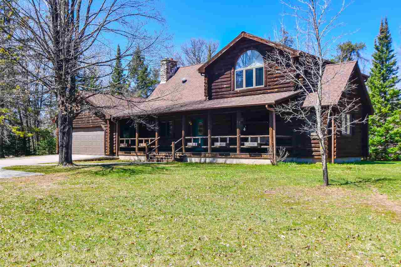 Beautiful Log home resting on 16.62 acres.  Custom Built Home with plenty of room, rustic appeal and field stone fire place. Follow the trails through this property leading you to a food plot with a sand point to water and elevated stand. The back end of the property bumps up against the Pike Wild River Public grounds, the Pike River runs through this public property!  Store all your toys in large shed (49x64') with enclosed lean to and heated shop plus additional outbuildings.  Property also includes a fenced in garden. 1ac Residential, 15.62 Prod forest zoning