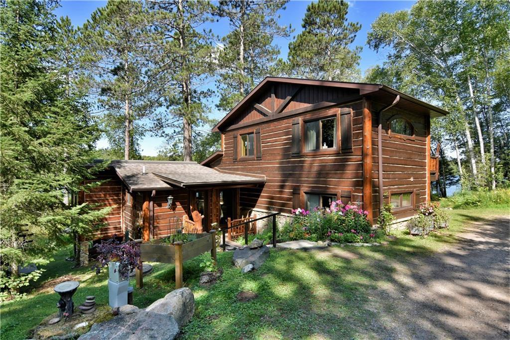 Welcome to serenity on Buffalo Lake! This 3-bedroom, 3 1/2 bath rustic log cabin has been updated with modern amenities. Surrounded by National Forest, the secluded location offers a hard-to-find PRIVATE setting on 40 acres with 1,000 feet of lakeshore. Sandy bottom frontage and clear waters offer great swimming, paddling, boating and fishing. Work from home in this comfortable cabin with high-speed fiber optic internet and good cell service. The charming log cabin has been beautifully modernized, expanded and upgraded with today?s comforts including state of the art kitchen with custom cabinetry, granite countertops, copper farmhouse sink, colorful retro style Northstar refrigerator and 6-burner Wolf gas range. The interior features a vaulted ceiling, tongue-and-groove walls and ceilings; hand hewn log beams, posts and railings; skylights; dramatic wood-burning stone fireplace with handcrafted mantle; and lakeside porch with panoramic views of the lake and woods.