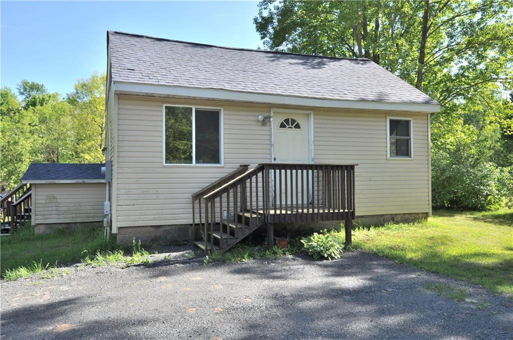 If you are starting out, downsizing or just looking for a hunting cabin this home is for you.  This home is located on 4 acres, 20 mins from Eau Claire and backs up to 2000 acres of  Eau Claire County Forest.  This home would also be perfect for the gardener or hobby farmer in the family.  There are already 3 separate areas fenced.  Home has lots of updates and so many more possibilities! A few updates include roof (2020), water heater (2018), Breaker panel box (2017), kitchen counter tops (2020), Flooring (2019) Building in back at one time housed a couple of cows.