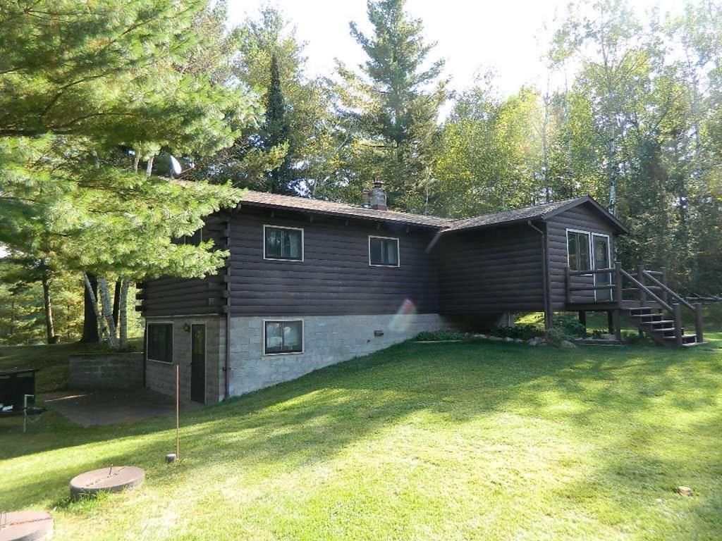 (215/DE) This is it! Level lakefront site with a raised ranch house overlooking Lake Winter on Everson Road. A 2 BR house with kitchen, dining room, living room, & vaulted ceiling that has been well cared for. Need more room? Basement offers a kitchen, family room & bathroom. There is a supplemental wood furnace in the bsmt. 3 car detached garage with power & a 2nd 3 car detached garage for toys or equipment. 1.05+/- acres, close to National Forest, ATV trails, etc. This can be your getaway location today! 2019 taxes: $1,761 (9-38-5W) If you need additional site area see MLS#181228, RANWW#1536061.