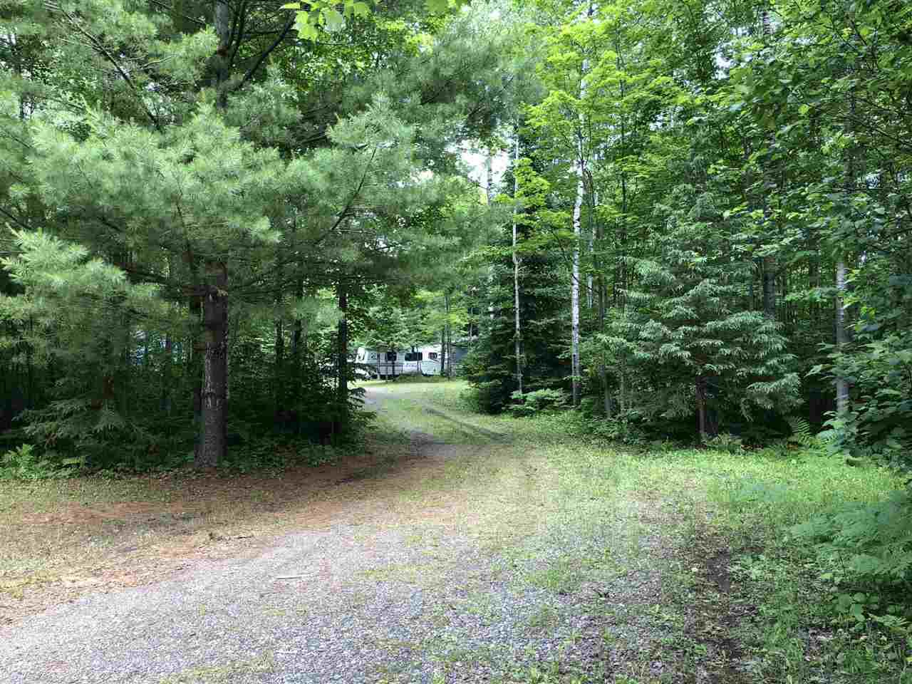 Motivated Seller!! Great turn-key opportunity for an affordable Northwoods escape near the lake, adjoining public land, and on ATV trail! This buildable 4.97+/- acre site in Price County would be a great family getaway offering abundant nearby activities. The property has a 31' camper and motor home for bunking along with four extra newer buildings: 8x16 shed for storage; 10x20 shed for the toys; 16x24 screen house with wood stove & heater for a hangout or extra bunking; and a nice clean outhouse that will impress with 1000-gal holding tank. Better yet, this site is equipped with drilled well and drinkable water per seller and is fully set up with solar power and generator! The great outdoors offers thousands of adjoining public acres in the Chequamegon National Forest, Sailor lake offers great fishing and a boat landing 1.5 miles away, and the ATV trail is at the end of the driveway! This site can be used year-round and snowmobile trail runs near the campground. Call for details or to take a look!