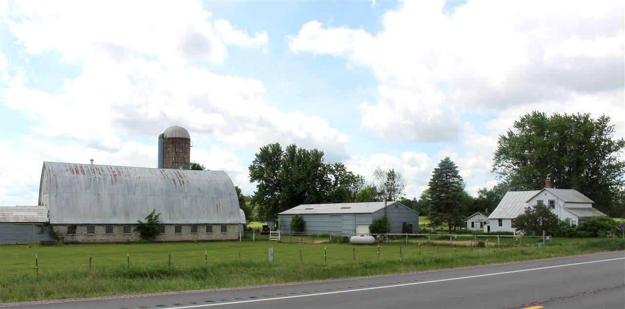 This is a rare find!  Has been owned by 1 family for over 100 years. Property is 170 acres and has water frontage on the Lemonweir River.  Approx 58 acres are tillable, approx 65 acres are wooded, and approx 47 acres are wetland along the river.  Includes an older 2 bd, 1 bathrm farm house, pole shed, barn, and many other outbuildings.  The home has potential to add 2 other bedrooms on the second level.   Sellers gutted the upstairs to remodel and decided to let the next owner make it their own.  Great hunting and recreational land and a very unique opportunity!