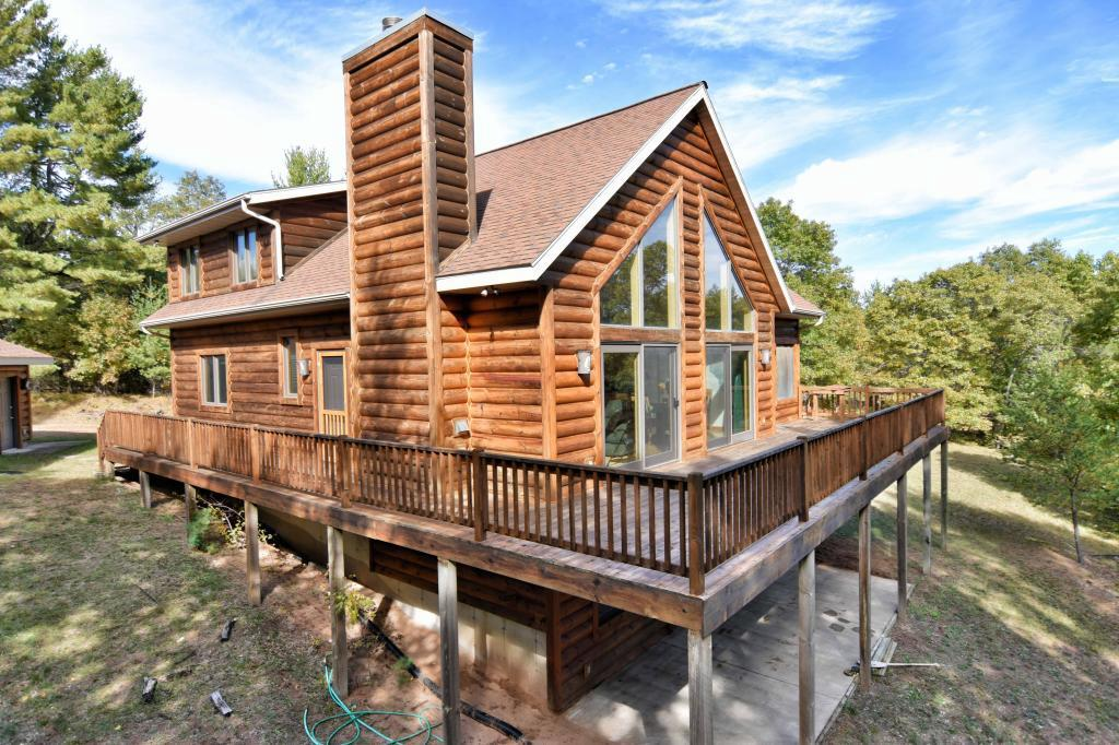 Rare opportunity to own 132 acres of pristine mature woods with very private Sherman lake 35 acres 11' deep, approx 3,500 of lake shore & approx 1,600' of river frontage.Lake has been known to produce some great fishing.Turn Key with a newer Chalet walk out 2900 sg ft 4 bed,3 bath home,decking,3 season porch, 2 stall detached garage. Includes furnishings. Watch Abundance of wildlife loons, deer, bear, turkeys,ducks, geese. Enjoy the 4 season with a 18 hole golf course, ATV/ snowmobile trails, hunting and fishing. Additional acreage and waterfront  available with the purchase of this property if desire