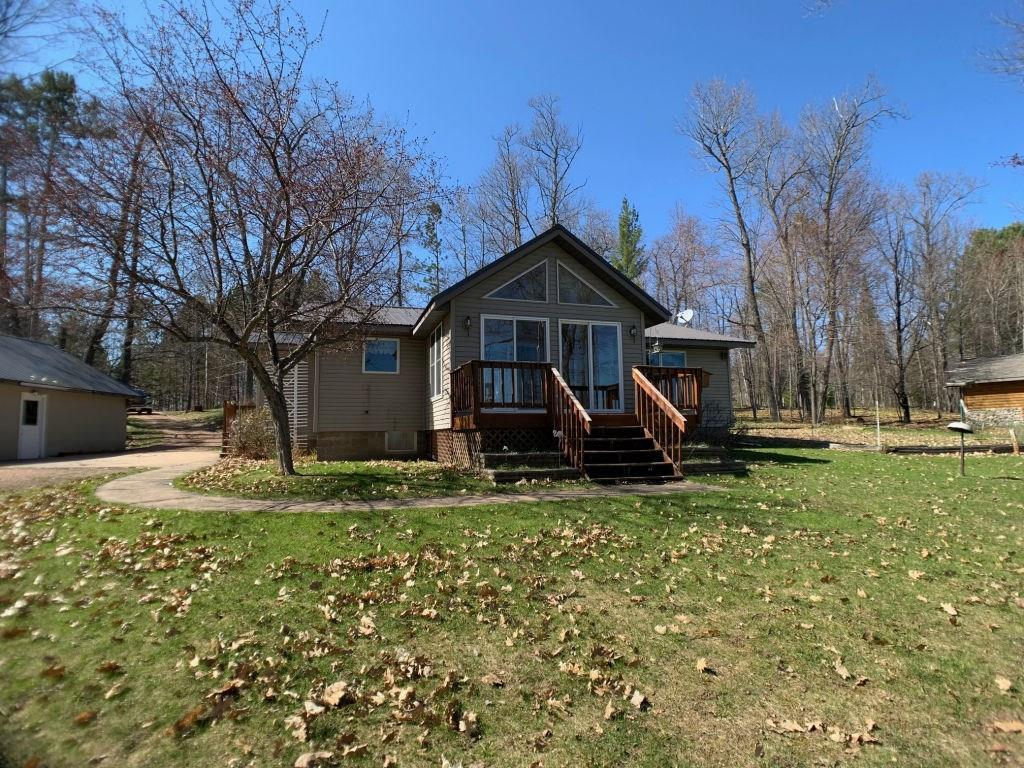 (257/PR) Choice frontage on Pike Lake! This well kept home offers fantastic water views and room for everyone. Main level features large kitchen with eat at bar, open dining/living room area, full bath, 2 bedrooms, plus a 3-season porch facing the lake. The partially finished basement is made up of a kitchen area with fridge, sink and countertop, a living area, full bath, and two finished bonus rooms. 2+ car detached garage. Recreation and relaxation awaits! Pike Lake is a 741 acre lake and part of the 1900-acre Pike/Round Lake Chain. Asking $283,900. 2019 taxes: $4,347.30. (26-40N-3E)