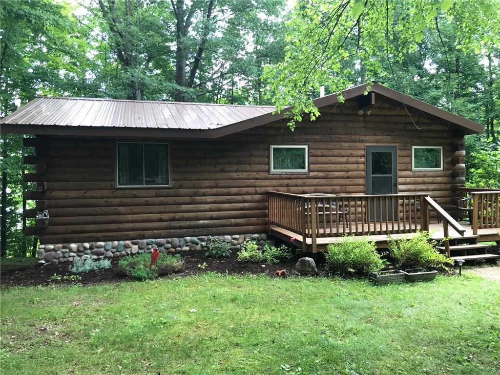 Cozy log sided cabin on one of the nicest lakes in the County! Island Lake is known for it's crystal clear waters with great fishing & pontooning. This log & stone sided Chalet is a well insulated cabin with lots of curb appeal. Cabin has: vaulted knotty pine ceilings,open kitchen. 2 decks; roadside & lakeside with  full walkout basement . Has detached 2 car garage for all your toys. Both Home & Garage have metal roof.  Also there is a firepit & new dock to waters edge. Newer metal roof, main floor laundry & 200 amp service to name a few amenities.  Gorgeous view of the Island. All on quiet little way minutes to Hayward, Ladysmith or Park Falls. Near golfing, ATV/Snowmobile trails, and  lots of Chequemagon Forestland nearby!