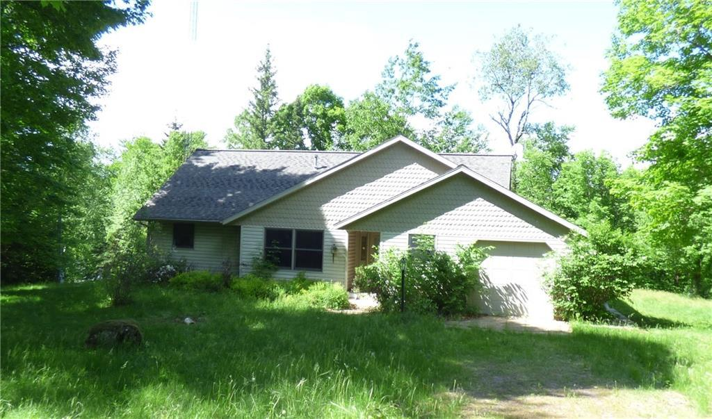 On the outskirts of National Forest lands in this popular recreational area sits this inviting 3 bedroom 2.5 bath get-away with 205' of frontage on the Chippewa River & easy access to Barker Lake or Hunter Lake.  Enjoy the privacy of the location and the spacious interior with open great room with gas fireplace, vaulted ceilings with skylights, ash floors and windows galore overlooking the river and the woods. Well laid out kitchen features hickory cabinets.