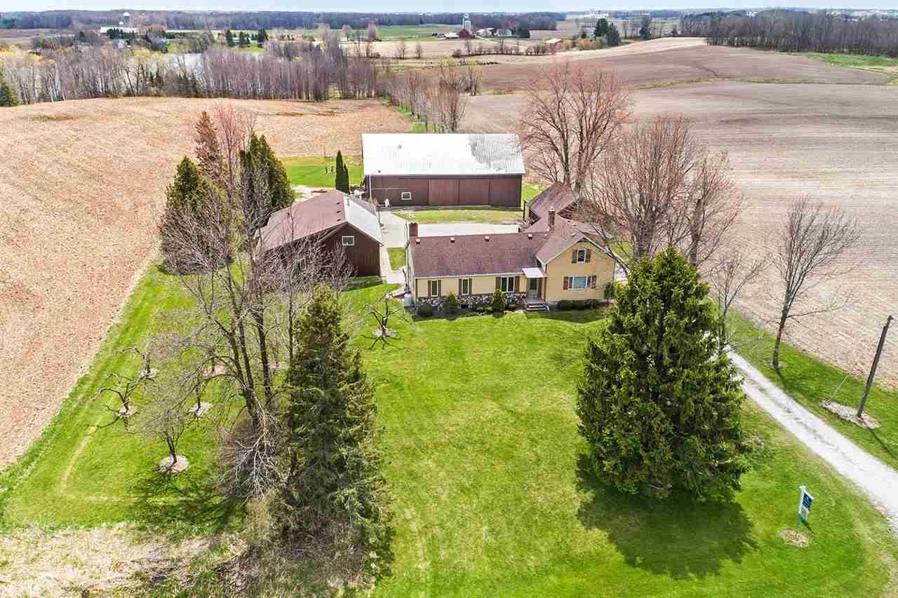 IDEAL COUNTRY PACKAGE ALL-IN-ONE! Totally renovated and addition added onto farmhouse originally built in 1875. Beautiful craftsmanship throughout w/maple cabinetry, sun-room, 1st-floor master bedroom, 1st-floor family room (GORGEOUS), skylight, radiant heat, LL partially finished. Over 647' of lake frontage on Carstens Lake (20 acre lake, no-wake). Barn (34x68); Grainary (20x30); detached garage (24x26); workshop (1476SF)...wood working shop & much more. PRE-CERTIFIED. Ideal location w/quick access to Hwy 42. Some tillable land & woods by lake.  Seller uses wood heat & lp gas boiler. WOW!