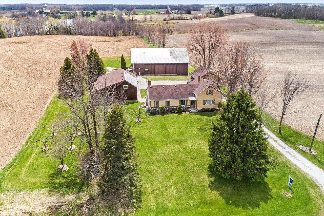 IDEAL COUNTRY PACKAGE ALL-IN-ONE! Totally renovated and addition added onto farmhouse originally built in 1875. Beautiful craftsmanship throughout w/maplecabinetry, sun-room, 1st-floor master bedroom, 1st-floor family room (GORGEOUS), skylight, radiant heat, LL partially finished. Over 647' of lake frontage on Carstens Lake (20 acre lake,no-wake). Barn (34x68); Grainary (20x30); detached garage (24x26); workshop (1476SF)...wood working shop & much more. PRE-CERTIFIED. Ideal location w/quick access to Hwy 42.Some tillable land & woods by lake. Seller uses wood heat & lp gas boiler. WOW!