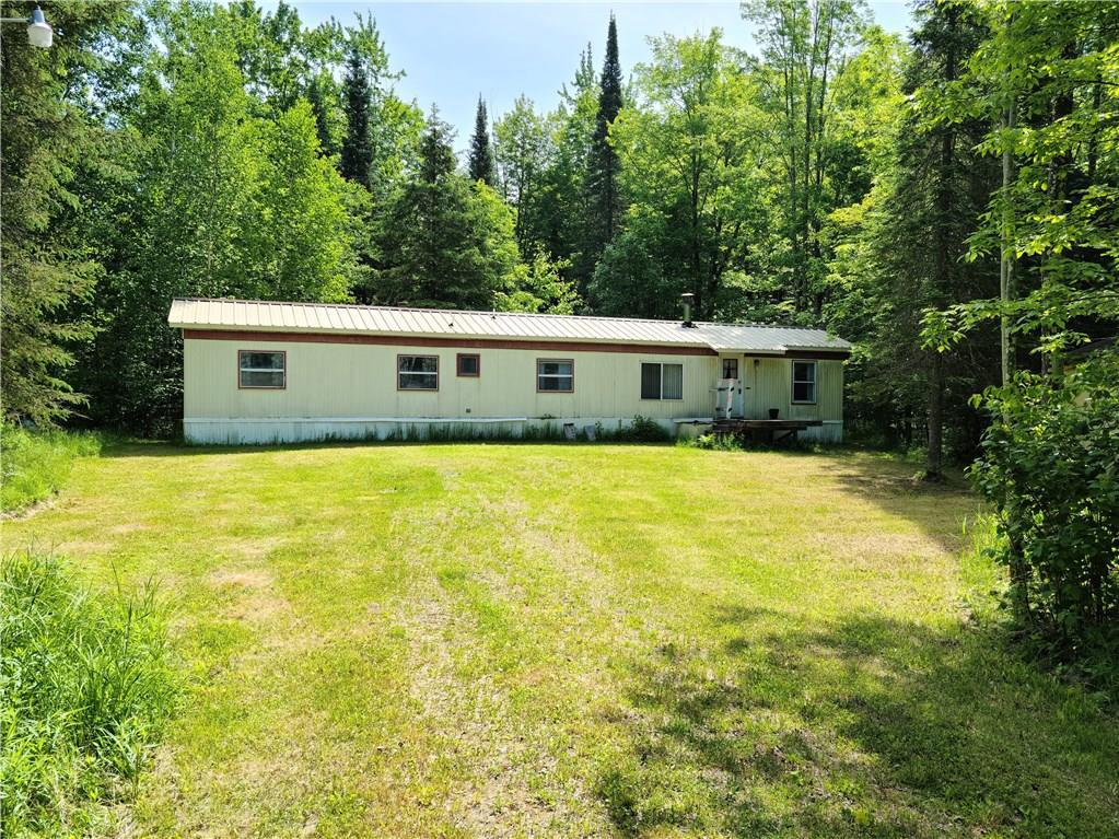 This three bedroom home hidden on a wooded five acres has been used as the perfect hunting retreat, but could also make a good home at a value price.
