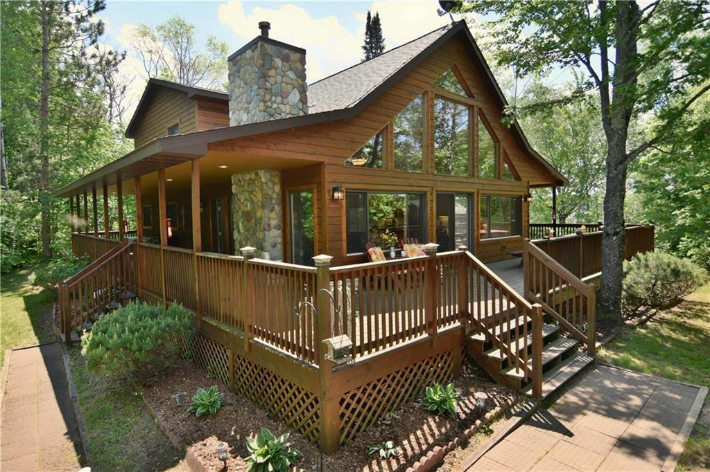 Here's a chance to own your own island. A very rare opportunity. Ideal for a Retreat or Vacation rental currently grossing over $60,000.00 + during the Summer Season with the opportunity to gross up to $20,000  more during the Winter months.This gorgeous home has vaulted wood ceilings, a stone fireplace, a huge wrap-a-round deck and a large master loft bedroom. This perfect vacation get-a-way is fully furnished plus comes with wi-fi, t.v, a pontoon boat and a mainland parking lot. Broker/Owned