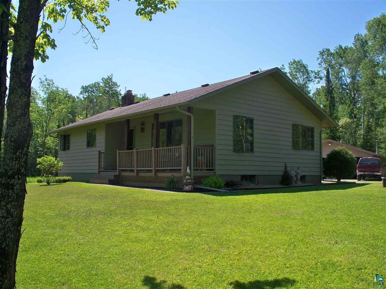 WOW. Enjoy 10.6 acres of part wooded and part open land, yet only minutes from Superior. Very well maintained home has had only one owner. Enjoy your morning coffee on the deck and watch the wildlife. This home features Cherry kitchen cabinets, newer appliances, formal dining area, spacious living room, 3 bedrooms and full bath all on the main level. New roof in 2020, Central air, city gas and drilled well. Full Basement with laundry and bath w/ walk-in shower. Family room with gas fireplace, game room, and much more. Cedar siding. Gutters. Over sized 26x36 detached garage w/wood stove. Property is beautifully landscaped and is nice and level. Small storage building for your garden tools etc. Pool Table is included (may want to place on Bill of Sale).