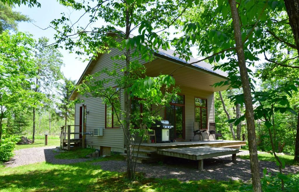 This is all you need to enjoy the northwoods! Newer, maintenance-free 1 bd/1 ba year-round cabin w/sleeping loft on over 3 acres w/212' Chippewa River frontage. Vaulted ceiling, pellet stove & covered deck w/river views. Serene, park-like setting w/low elevation to sandy-bottom river. Cabin sleeps several comfortably plus land set up for trailer camping. 20x30 garage w/loft for toy storage needs. Excellent musky & smallmouth fishing, jon boating, kayaking/canoe or tubing. ATV/snowmobile-Tuscobia Trail.  Add'l acreage/frontage avail.