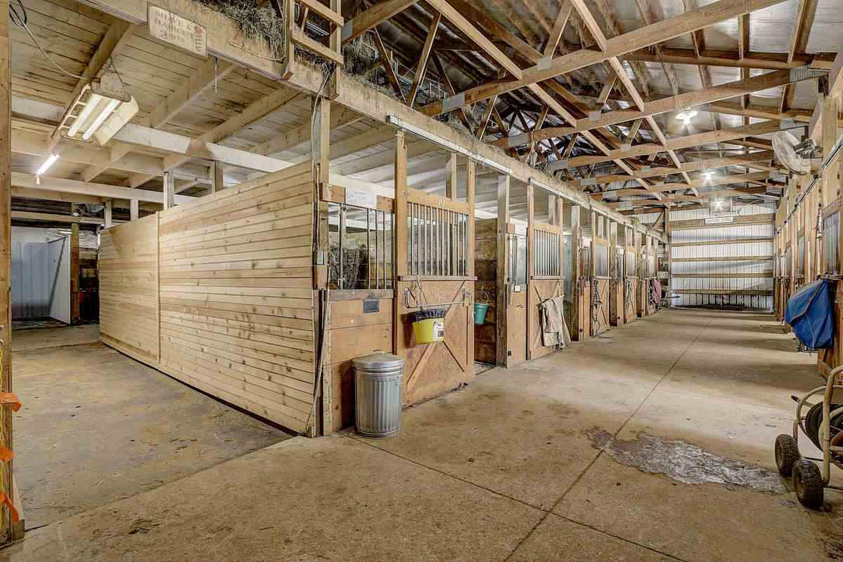 This Equestrian Farm is one of a kind!! Features: Geo-thermal heating/cooling, wood flooring, granite counters, Amish built cabinetry, finished walkout LL with 2 bedrooms, bath & family room & so much more! Home built in 2016 by Wynn Construction(Paarade of home builder).This 35 acre Horse Farm has a 70x70 barn(2004). Features: horse stalls,120x60 indoor riding arena,horse washing room,upstairs break/office room(with small kitchenette and bathroom). Electric, gas,private septic for barn. Land includes 23 ac. tillable (just enough to grow your own hay) and 7 ac. pasture.  Located on a dead-end road with views of 2400 acre mud lake conservancy. Only 20 minutes to Sun Prairie, 25 minutes to Madison and 15 min to Lake Wisc.