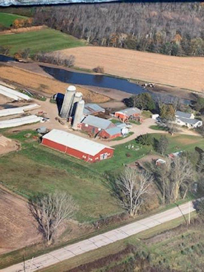 57.84+/- acre farm with 2 story, 5 bedroom, 1.5 bath home.  Full basement with 24x24 finished rec room.  Attached 2 car garage.  Lean-to, granary, pole buildings, barns and utility shed.