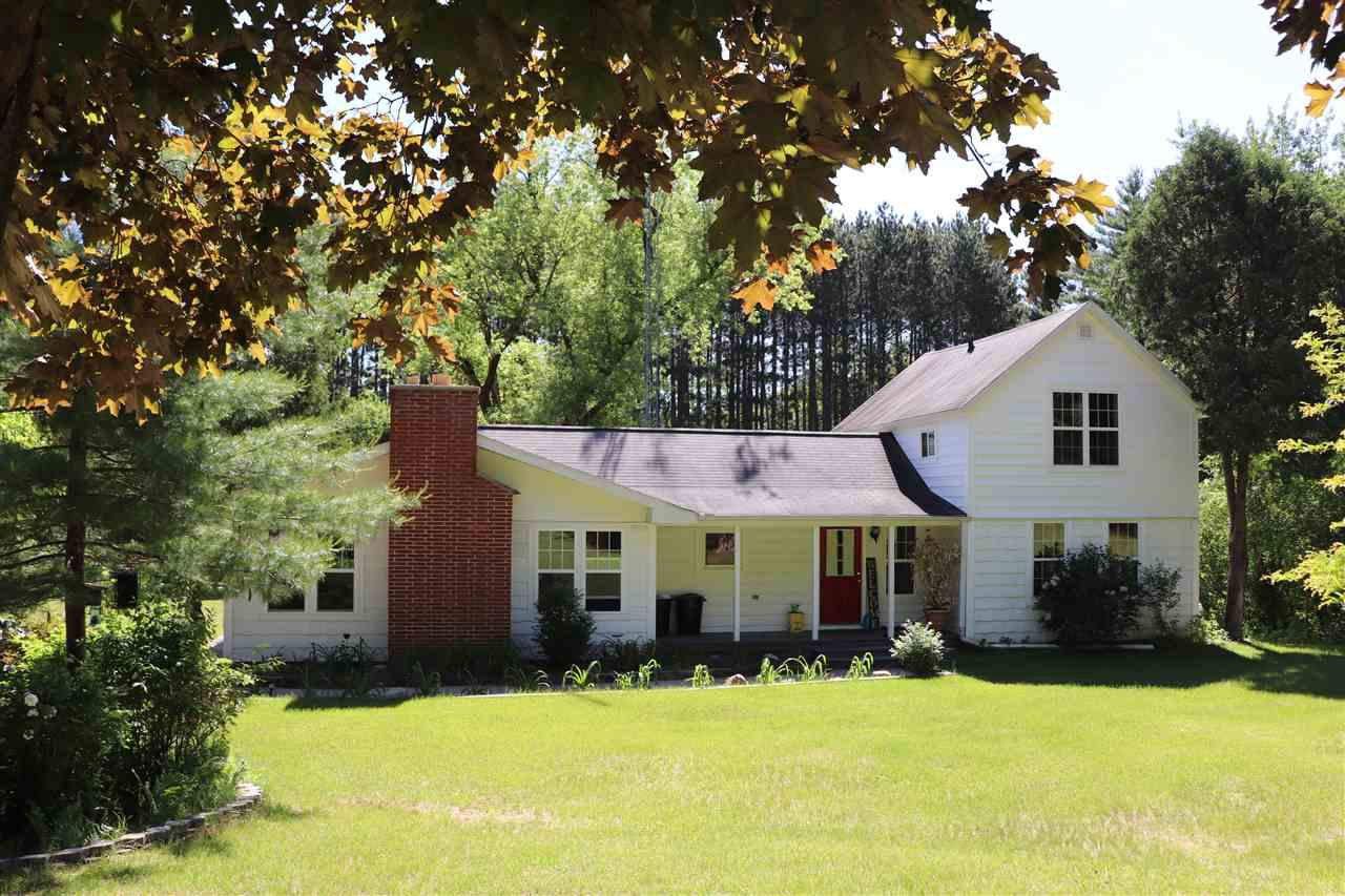 Redgranite - Country Farmhouse on 2.5A. Charm & character with upgrades: Windows, flooring, spa/hot tub room, upgraded bathroom, septic, much more. Large size kitchen with beautiful cabinets, and workspace, fireplace in living room, master suite has new bathroom, relax in the spa room, sky windows open for star gazing. Upper level has one Bdrm and half bath. Newer addition has basement with storage room. 2car detached garage plus 60x100 workshop - hoist, tire - changer, air compressor included. Shop is heated w/ office area. Shop part zoned CG. Home zoned AG. Beautiful landscaping. Call Now.