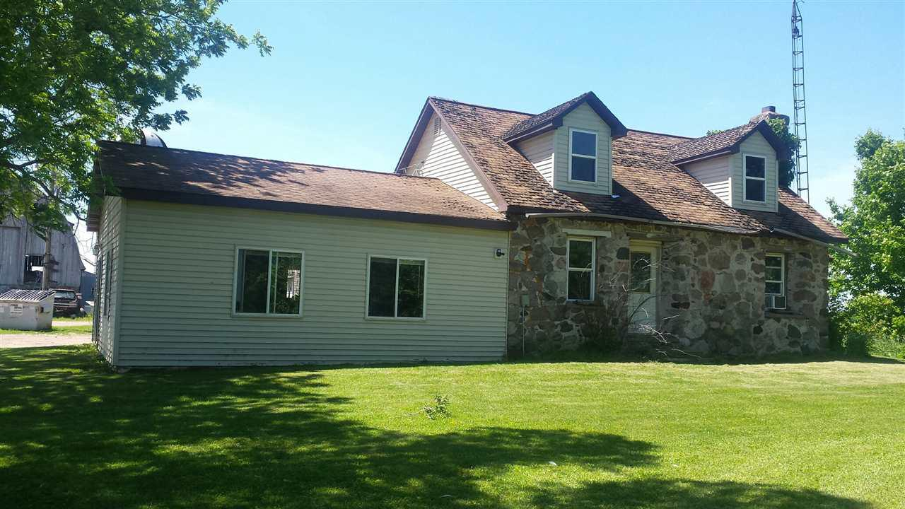 80 acre hobby farm, 35 tillable acres, 22 acres of woodland balance pasture and farmstead buildings.  Remodeled house, outside wood burner, located in quite area in Rusk County. Needs a little TLC. The barns will be i shape for horses, beef cattle or any animals you desire.