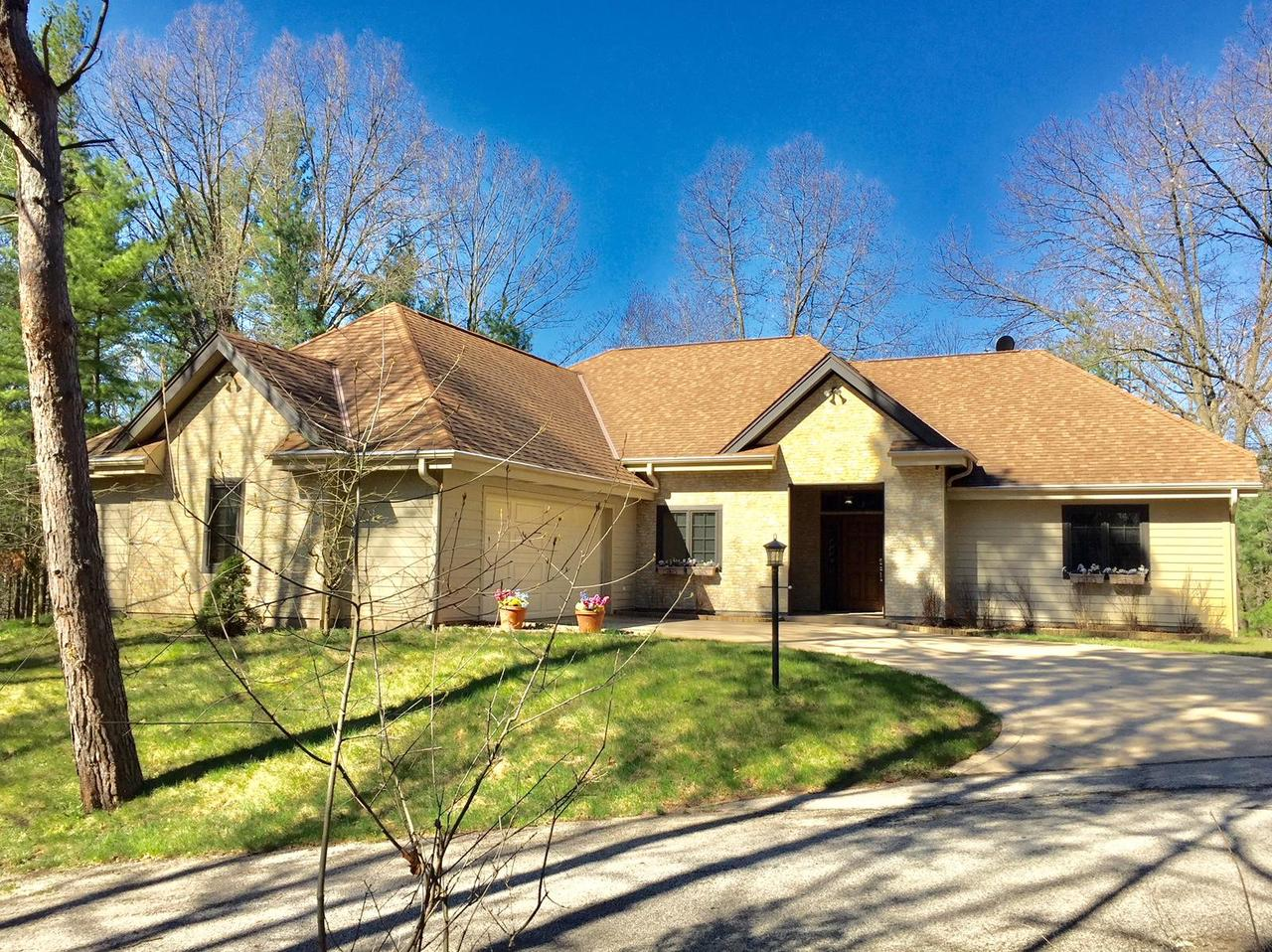 Stunning 4 BR, 3.5 BA custom built ranch home with finished walk-out lower level is located on an incredible 5 acre parcel located in the desirable Forest at Farmington gated community. Beautiful wooded lot with clearance around the home and a winding creek running through the property. Impressive foyer with covered entry sets the tone for the rest of the home! Great room features a corner FP and French doors leading to a sunroom that overlooks the yard. Kitchen has huge walk-in pantry, and spacious dining area! Split bedroom floor plan! 10 ft ceilings throughout! MBR has custom shelving in huge WIC, Master bath with jetted tub and steam shower. BR 2 and BR 3 are very nice size with built-in murphy in BR 3. Lower level features Family Rm, BR 4 and full bath.
