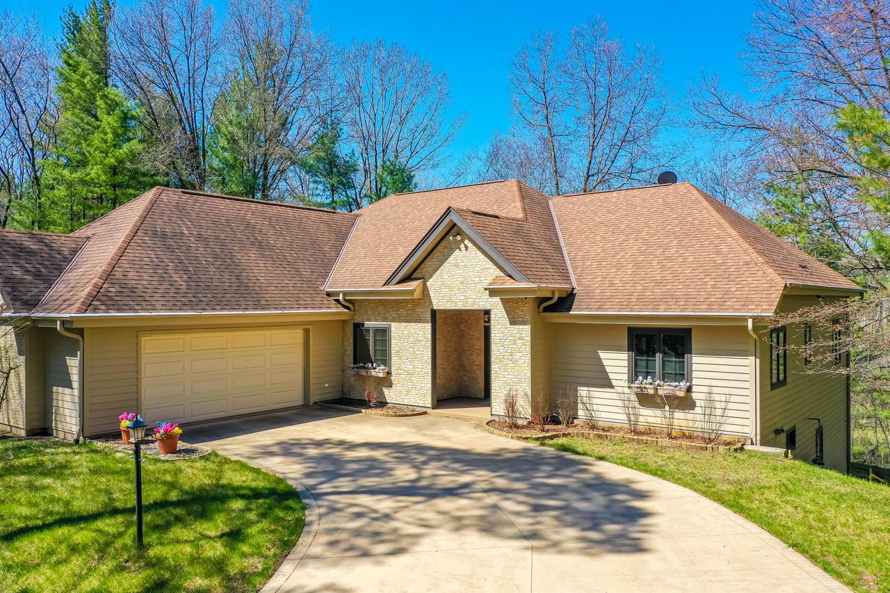Stunning 4 BR, 3.5 BA custom built ranch home with finished walk-out lower level is located on an incredible 10 acre parcel located in the desirable Forest at Farmington gated community. Beautiful wooded lot with clearance around the home and a winding creek running through the property. Impressive foyer with covered entry sets the tone for the rest of the home! Great room features a corner FP and French doors leading to a sunroom that overlooks the yard. Kitchen has huge walk-in pantry, and spacious dining area! Split bedroom floor plan! 10 ft ceilings throughout! MBR has custom shelving in huge WIC, Master bath with jetted tub and steam shower. BR 2 and BR 3 are very nice size with built-in murphy in BR 3. Lower level features Family Rm, BR 4 and full bath.