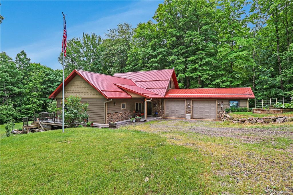 This magnificently manicured property is privately positioned on the Chippewa River. The property is a relatively newer house that has a great open concept floor plan that can be enjoyed by the entire family! Two bedrooms on the main level and bonus room in the upstairs offers the space your family and guest are looking for. The garage is insulated and heated. This part of the river offers some of the best swimming  of the entire river and easy access for canoe and kayaking.