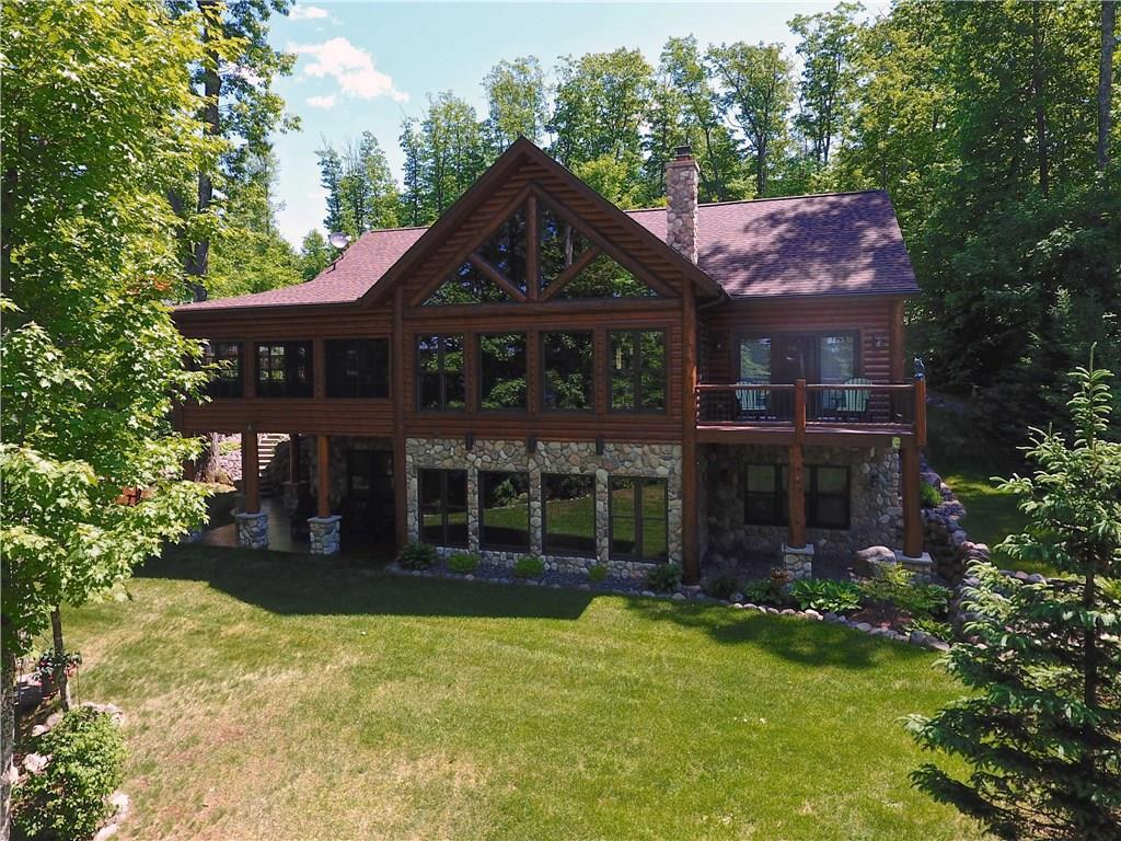 Exceptional home with top of the line custom features on one of the cleanest and clearest lakes in Northern WI. Quiet and serene setting with abundant wildlife and excellent westerly exposure with incredible sunsets. No expense was spared and no detail missed. Built in 2006 by a premiere area builder this home has been exquisitely maintained. Open airy floor plan w/ many gathering areas for groups of people, yet cozy well designed spaces for a private oasis. Top of the line appliances and fixtures throughout including Viking cook top. Lot to the South can also be purchased to expand privacy and lake frontage. .25 acres of the back lot will be included with this price or you could purchase the full 5.25 acres for an additional amount. Furniture avail. & negotiable.