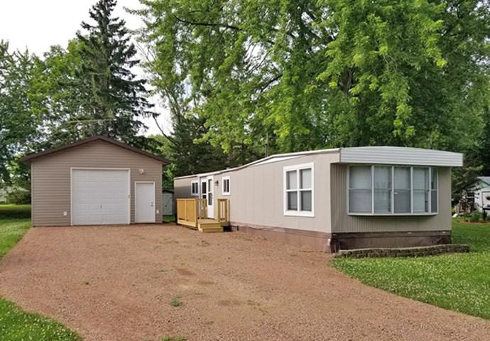 Looking for affordable housing or a new rental for your portfolio? Then here you go! This 70x14 mobile home can keep the payments down or keep them coming in. Has newer vinyl windows, new wall A/C unit, new front deck and back porch, insulated detached garage with 10 foot side walls & 100 AMP service, updated kitchen, new well in 2013, and a nice storage shed for all your outside tools; all located in downtown Chili. Very easy to show, so set up your personal tour today!,Acreage is an estimate per assessor