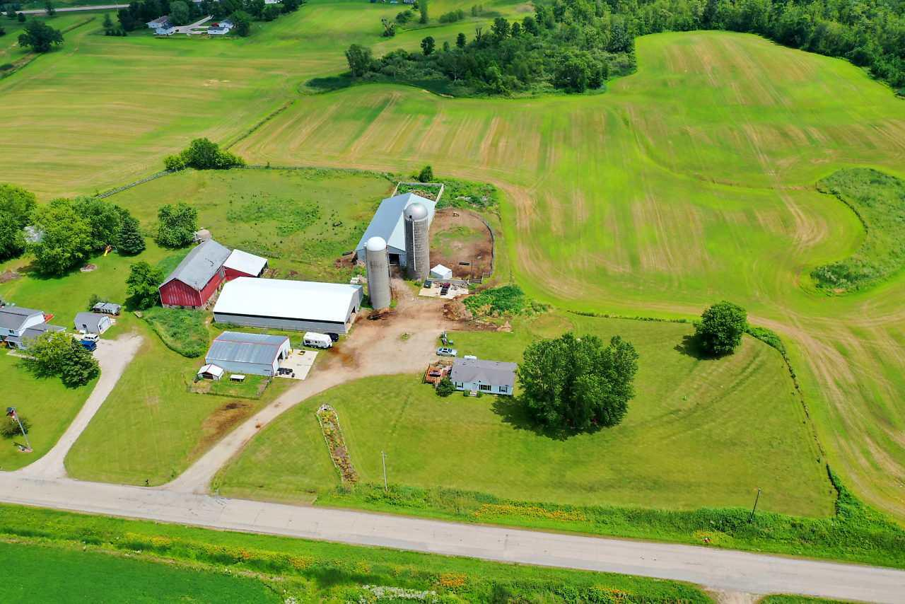More than $170,000 has been invested into this property per seller! Features include a horse lover's dream building with 6400+ square feet, 13 stalls, an indoor riding arena, and a 24x17 heated washroom with hot and cold water, an additional building with 6000+ square feet previously used for livestock, a 1900+ square foot garage for cars, equipment and storage, an additional barn with storage options, loafing sheds, silos, a manufactured home that's been updated with flooring, appliances, bathroom updates, a furnace, deck, drywall, light fixtures and more. So many possibilities here!