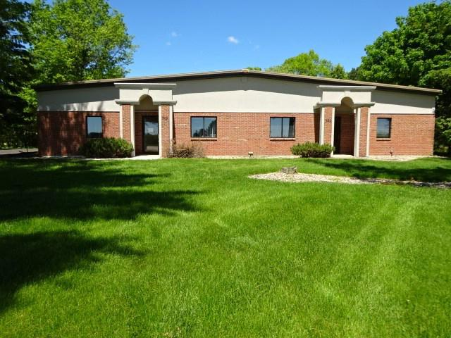 """ For Lease "" a 7,500 square foot professional office building.  The lease rate is $11.00 psf Gross lease for $6,893 per mon, with the tenant paying for utilities, snow/ice removal, lawn care and janitorial.  Features, are 12 + private offices, large conference, training room, reception waiting room,  kitchenette, 7 ADA  restrooms , in move in condition.  The office ceiling are 9 foot and the entry and conference room have 10 foot ceilings, thus giving you the feeling of more space. The building has internet fiber optics and the office rooms are all wired.  Also 3 phase electrical.  All the quality desks and tables are in place for the new tenants use if you like, for no additional cost.  The building sites on 2 Acres, zoned M2 Heavy Manufacturing. Black top parking lot.  Rents to increase 3 % per year after the first year, lease terms 3 to 5 year with options to renew.  Landlord would consider lease either 1/2 of the building being 3,760 Square feet.  The 300 Plover Road, East side of the building has a insulated warehouse at the back with a 10 x 10 OHD.  Move your business here."