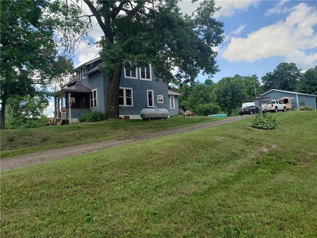 Country living within feet of Blake and Little Blake lakes on 1.69 acres in beautiful Polk County.  Out buildings for storage with large yard to do whatever.