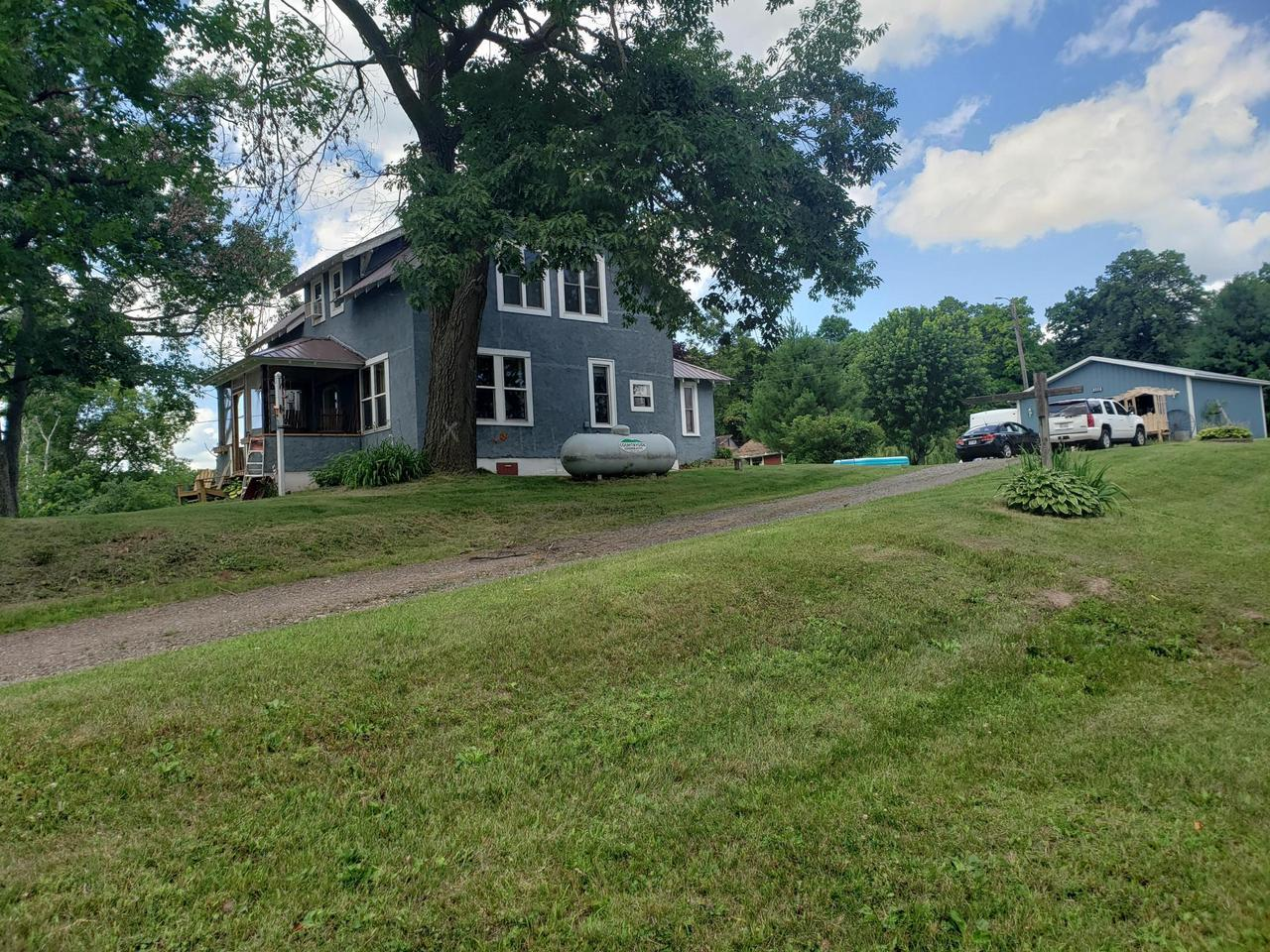 Beautiful country living within feet of Blake and Little Blake lakes on 1.69 acres in Polk County. Out buildings for storage with a large yard.