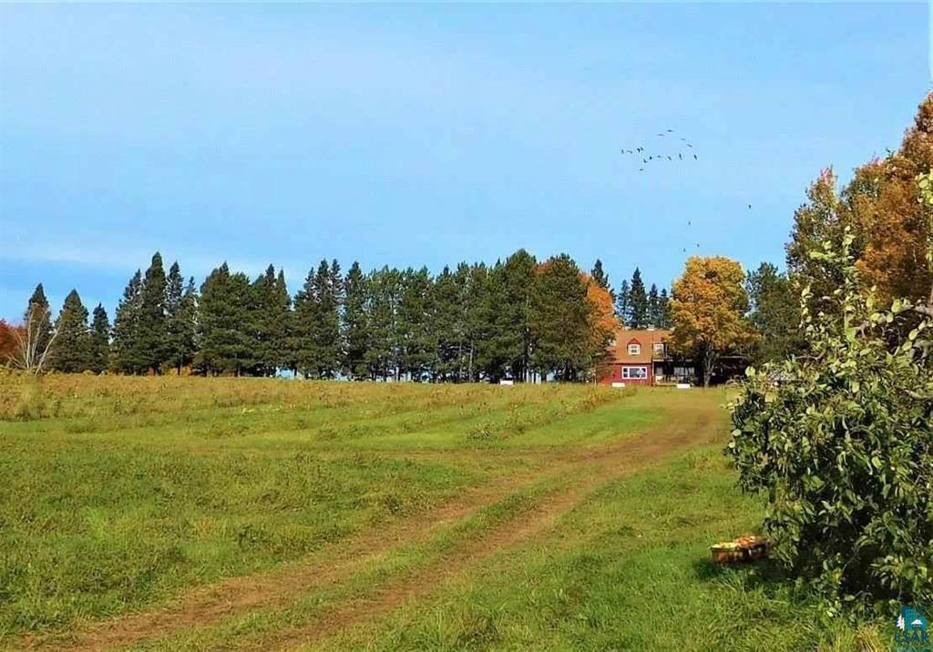 145 +/- acres in combined parcels of historic farmland, orchards, vineyards, fruit trees and berry patches awaits your vision! High in the picturesque hills & orchards of Bayfield this property is on the ?Fruit Loop? and nestled amongst seven spring-fed ponds. You?ll find 9 acres of northern varietal grapes along with numerous varieties of apples, berries and hazelnuts. Currently operated as a unique & successful family owned winery for twenty-five years. The historic farmhouse has four bedrooms, two full baths and two half baths. The main level houses a newly built commercial kitchen designed by a professional chef, tasting room, office and two restrooms. The upstairs is currently used as employee housing and includes a new septic and separate tank for the kitchen. You and your family can relax with a pastoral view of the vineyard & orchards from the upper and lower decks. This year-round operation includes a nearby state-of-the-art production facility with fourteen ft. dock doors on five acres. All licenses, permits, approvals, machinery, recipes and branding are included. Eighty-two acres of conservancy adjacent to the property are held for green space. You?ll enjoy sharing this area with numerous wildlife including eagles, deer, wolves, beavers and birds. With room to grow, endless possibilities await this special and unique opportunity!
