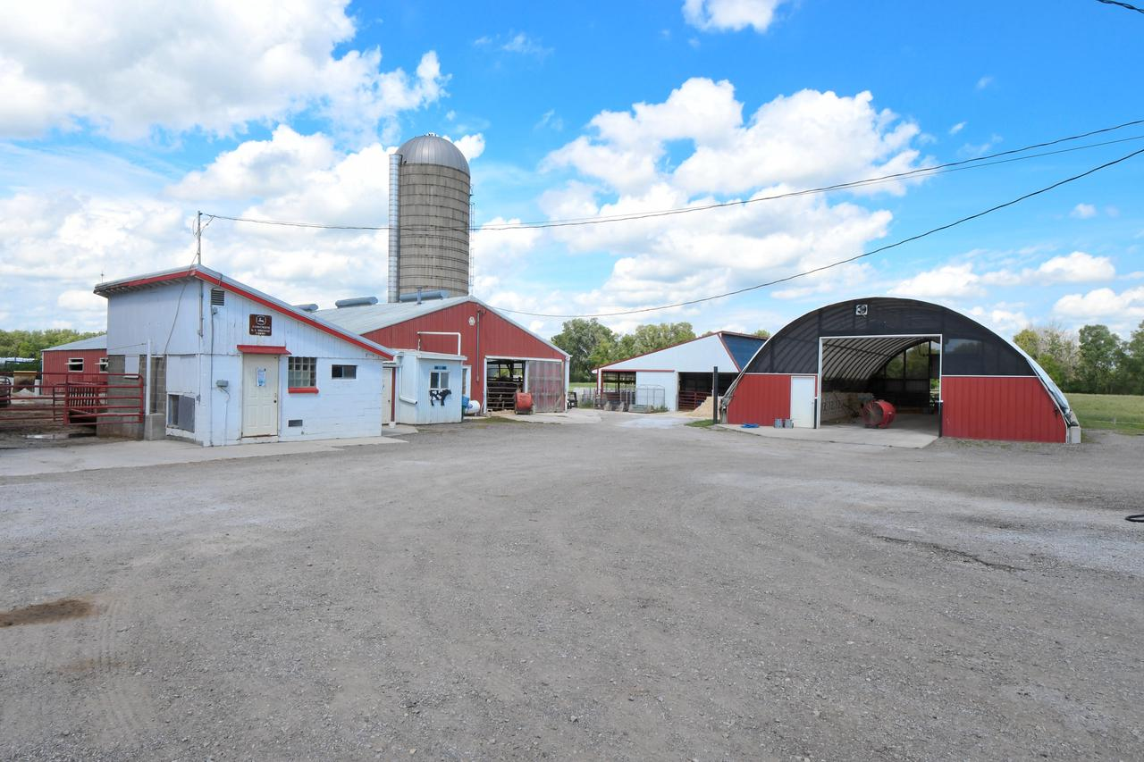 WELL-KEPT, WORKING, ORGANIC FARM with remodeled farmhouse, 119 acres and 47,000+ sq ft of newer outbuildings! Shop, storage, barn, cattle pens, hoop structure, and MORE. If you want storage this is a dream come true, but it could also support a landscape business, homesteading, orchards,.... Solid brick home features 4yo kitchen with Amish hickory cabinets, quartz countertops, and SS appliances; spacious living room; master bedroom; 1st floor laundry; and office that could also be a bedroom. There's plenty of room upstairs for your master suite, or 3 bedrooms, or whatever suits your needs. Full height basement with outside access. Fantastic shop space with in-floor heat. The outbuildings are in super shape and ready for your ideas. See documents for list of outbuildings. Call today!