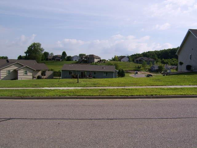 Great lot, in a residential subdivision, for a fully exposed, walk-out lower level.  Great location, close to the entry of the Red Hawk Valley subdivision.  Enjoy the great views of the valley, walking paths and neighborhood park.  Easy commute to surrounding Villages.  Close to Middleton/Madison for shopping or work.  Bring your own builder.