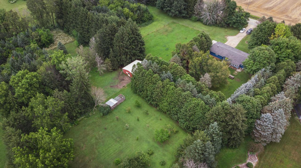 Beautiful Hobby farm with ranch style home on 6.39 acres of land with 3 bedrooms and 1.5 baths. This home gives you a large living room and a separate family room with a fireplace. Many recent updates throughout the house inside and out. There is an attached greenhouse for your gardening pleasure. Property includes a 30x30 barn that currently has 2 horse stalls and room for another if you would like. 2 large fenced in grass pastures and a dry lot. Chicken coop and a garden shed. Orchard includes 7 apple, 2 pear, 4 peach, 2 apricot and 2 plum trees. There are beautiful mature trees all throughout the property. Beautifully maintained and move in ready! Don't let this pass you by!