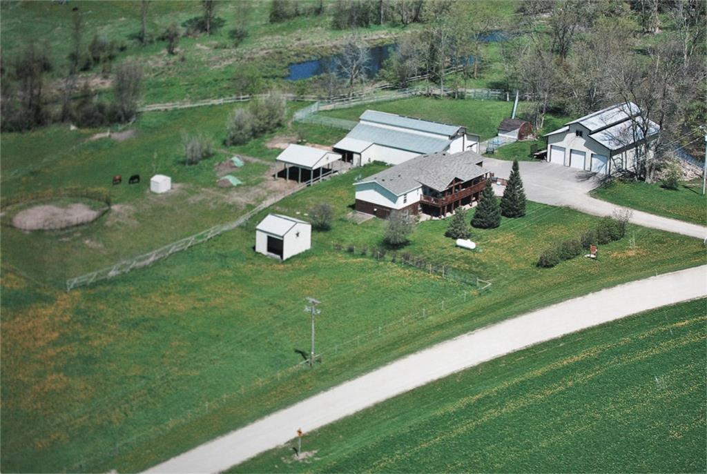 Make your move to they country! 11+ acre hobby farm with 6 bedrooms, 5 bath home and buildings for all the animals. Home features large kitchen with commercial appliances, private master, lower level 2nd kitchen, in-floor heat. 36x60 barn with stables, kennels, office and tack room. Large insulated garage with two heated rooms on second level. Fenced pastures. Creek and pond. Pole building for additional storage or animals. Property has kennel permit that stays with the property. Baldwin-Woodville School District. This one has everything you need!