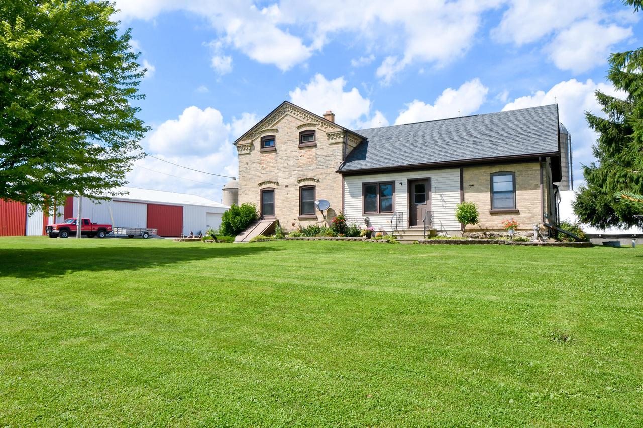 WELL-KEPT, WORKING, ORGANIC FARM with remodeled farmhouse and 47,000+ sq ft of newer outbuildings! Shop, storage, barn, cattle pens, hoop structure, and MORE. If you want storage this is a dream come true, but it could also support a landscape business, homesteading, orchards,.... Solid brick home features 4yo kitchen with Amish hickory cabinets, quartz countertops, and SS appliances; spacious living room; master bedroom; 1st floor laundry; and office that could also be a bedroom. There's plenty of room upstairs for your master suite, or 3 bedrooms, or whatever suits your needs. Full height basement with outside access. Fantastic shop space with in-floor heat. The outbuildings are in super shape and ready for your ideas. See documents for list of outbuildings. Call for a private showing.