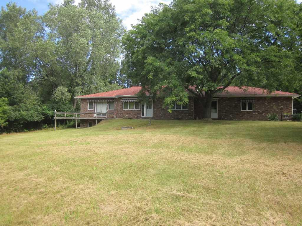 Tucked away on 40 wooded acres at the top of the north ridge on the Baraboo Bluff range and is situated between Baraboo and Reedsburg is this 3 bedroom, 3 bath ranch with a heated 2 car attached garage with drain that is just waiting for you to call home. Dual sided fireplace separates the living and dining rooms. Eat in kitchen with oak cabinets and breakfast bar, main floor laundry and a master bedroom with a walk in closet and jetted tub are just some of the features on the main floor. Finished basement that has large rec room with a free standing stove, storage room and full bath to entertain. 45x40 shed with 33x20 addition that has 4 horse stalls, heated shop area, water, electricity and is cemented. Open front shed 30x20 and a 20x10 horse shed. Good Hunting and a Great Opportunity!
