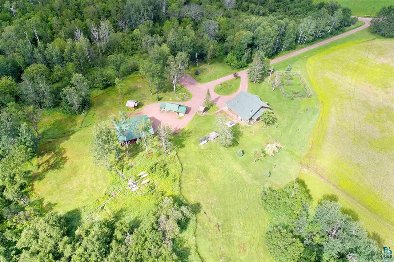 On a sweeping forty acres surrounded by beautiful views sits a cabin and numerous outbuildings with 1110' of White River frontage. This is the perfect location for your hunting group or family get-a-way! Private gateway access to 2000 acres of DNR and Bayfield County land, Trophy Deer Property and the White River is a Class A trout stream. The charming log cabin is a work in progress and needs some finishing. The main level has soaring ceilings, open concept living space & kitchen, two bedrooms and a full bath. The upper loft makes a great sleeping area and also has some space for storage. Furnace, boiler and fireplace heating options. A gorgeous drive through rolling country hills and only twenty minutes to Ashland and the beaches of Lake Superior. Property abuts three sides to DNR and County land. Norvado fiber optic.