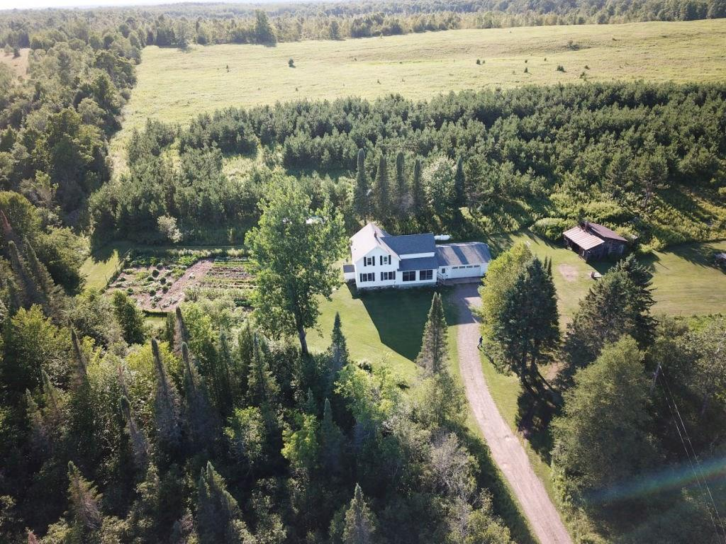 (155/PR) Has the Ultimate Country Property always been a dream of yours?  Wake Up! ? to this Classic 4 bedroom farm house on 106+/- acres with almost 1500+/- ft. of frontage along the Chippewa River. Located south west of Glidden, WI, this property is a must see. The 2 story home has been tastefully updated throughout with beautiful hardwood floors, beadboard wainscoting, Birch cabinets, tile showers, and large kitchen island. First floor features master bedroom with attached laundry room, spacious open concept kitchen/dining room perfect for entertaining, large living room, and full bath with whirlpool tub and tile shower. Second story consists of 3 bedrooms, full bath, as well as a large bonus room with knotty pine walls and Maple floors. The rolling acreage offers a wildlife paradise with over 20 acres of open fields, 40 acres of professionally managed hardwoods, red pine plantations, pond, and a 1/4 mile of frontage along the Chippewa River.  Make this your Legacy Property today!