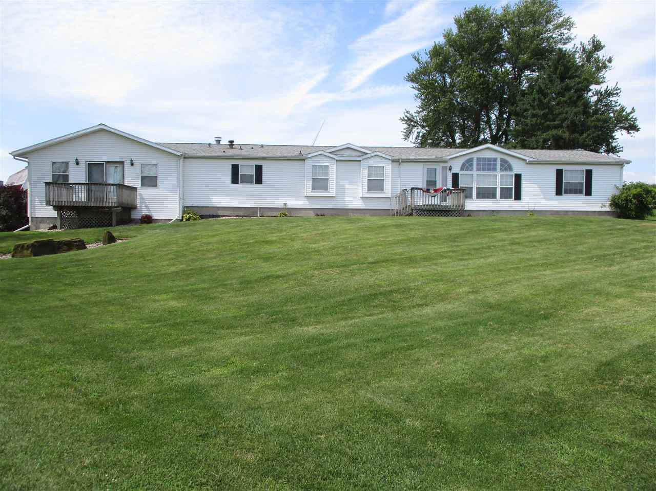 Farmette presently dairy goat farm, ranch house-outbuildings in excellent condition!  1-story manufactured ranch home.  Very well maintained and attractively landscaped.
