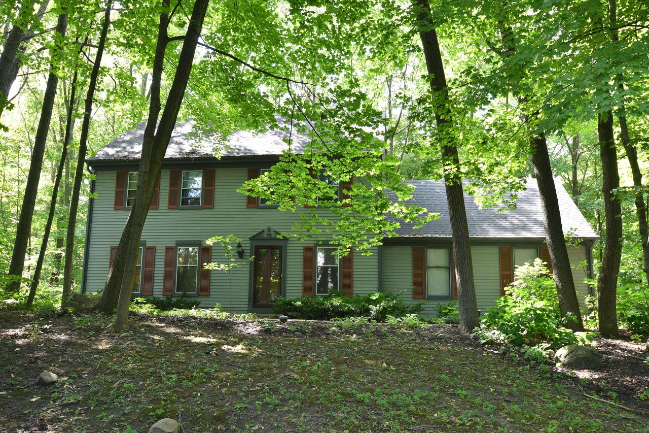 Affordable well-maintained 3BR 2.5 BA Colonial in the heart of Slinger! Private wood (one acre lot) with creek gives you the feel of being Up North,only mins away from Hwy 41.Great layout with LR in front and FR in back of the home with patio drs galore opening onto your lg private deck with beautiful wooded views! Kit has pantry, Corian ctrs, Pergo wd flrs, newer SS appl & is open to the dinette and FR with NFP. Main lev laundry. Upstairs you have a huge Mstr suite w/ vaulted ceilings, including WIC, NFP in sitting area with patio drs to your priv balcony.Att Mstr BA w/several upgrades.2 addl. BR and full BA.Located in private Scenic Moraine Parc Subd with access to the stocked pond & priv park. See list of upgrades in Documents.LR,DR,FR fresh paint, steps,hall, Mstr BR new carpet thiswk