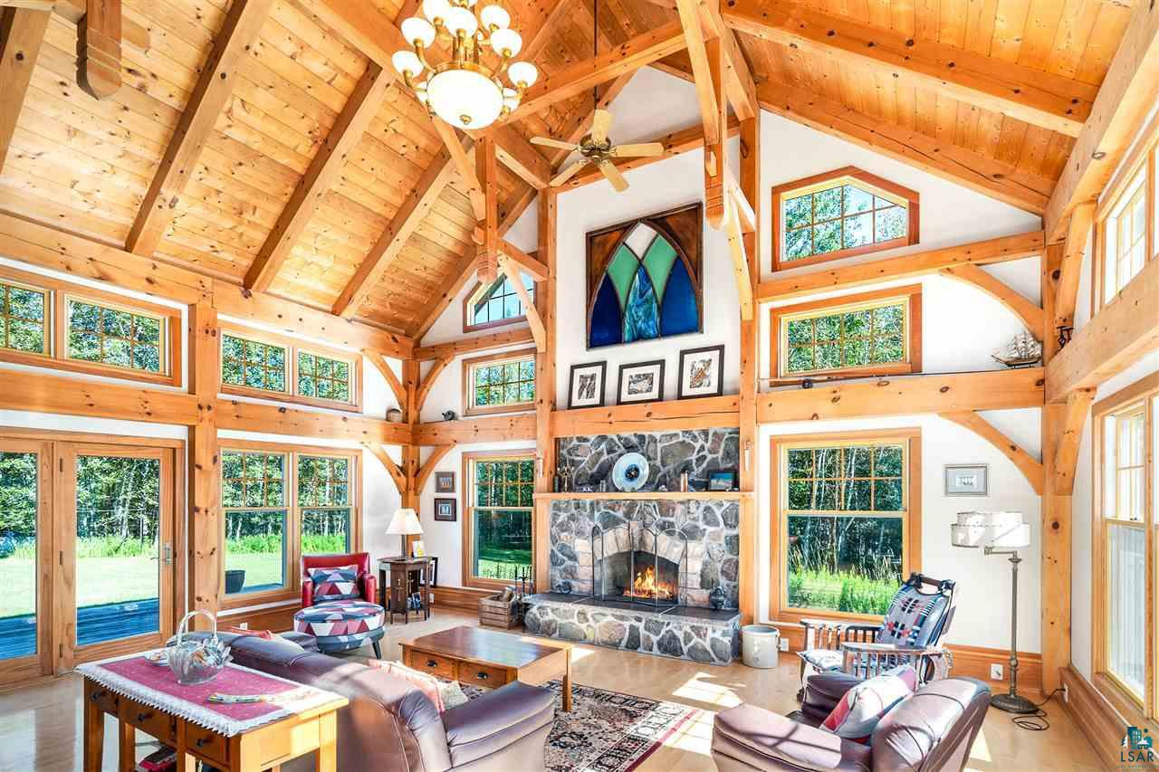 Lake Superior Frontage?440 feet. House is designed to all Great Lake Shoreline standards. The home is timber frame style using white Pine. Structural insulated panels (SIP) exterior walls and roof. Very energy efficient. Anderson triple glazed windows with storm and screens. Maple hardwood floors throughout home. All interior trim is white Pine to compliment the frame. 12? Pine mopboard is the chase run for the electrical and Cat 5 cable. Living Room ? Hammer beam style frame design. Traditional wood burning fireplace, stone is blue stone from quarry near Oulu, WI. Fireplace opening is lined with Sandstone blocks, also local. Built in cabinet shelves hides the TV. Railing overlooking the Living Room was salvaged from a railroad overpass in Superior. Custom chandelier with matching fans. Dining Room-Walnut wood insert delineates the area, with the bonus of knowing which way is North. French doors lead to Sunroom. Kitchen has Cherry cabinets. Butcher block countertop. Gas stove also has a removable grill burner. Entry/Mudroom has heated floor and built-in benches. Basement has heated floor by hot water hydronic with electric boiler. Walkout leads to Patio with Sundance hot tub for 6. Two furnaces-zoned forced air primary gas. Central Air and Air Exchange unit incorporated. GUEST HOUSE-Attached to main house by covered walk way. First floor has in floor hot water hydronic heat. Cedar sauna. Yodel wood burning stove in the upstairs Living Room. Maple hardwood flooring. Antique spiral staircase from the Trade and Commerce/City Hall building. Covered walkway could be enclosed for 3-Season Porch. Both houses have exterior Cedar siding and Cedar shakes with all windows trimmed in Cedar. Pole building is 50' x 50' with concrete floor. Electric wire is enclosed in metal conduit. Two large sliding doors, capable of accommodating large vehicles. 15' x 30' is a finished, heated Workshop. Private cased well. Black granite curbs used for exterior retaining wall by hot tub and around the garden area. The curbs were mined near Ashland, WI and salvaged from a city street project. Yard is graded to have positive drainage from all foundation drains by gravity and not the use of sump pump. Home is located between the Amnicon River and the Middle River on Lake Superior South Shore. Close to Brule River State Forest which has excellent fishing, canoeing and cross country skiing. Proximity between Duluth, MN and Bayfield, WI allows for numerous recreation and social activities.