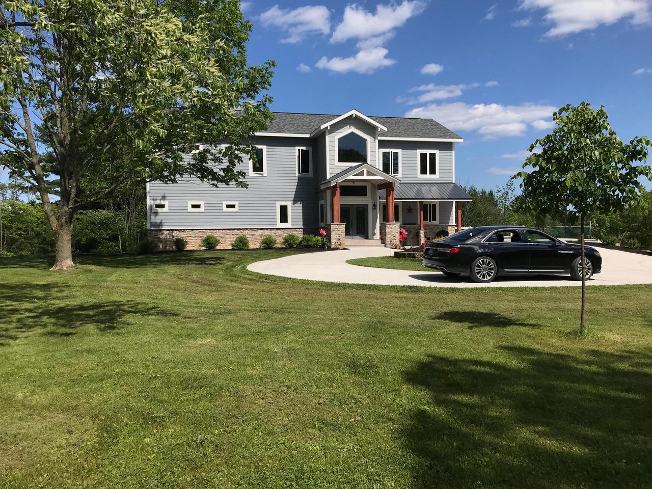 Beautiful 2015 custom designed home located in Town of Sheboygan (desirable Kohler School District) on forested land at end of Greendale Rd. Option to subdivide per CSM up to 3 additional lots (sewer & water installed). Addl. commercial land avail. = over 20 ac. Open area suitable for horses, w/ zoning approval. Orchards abut conservancy. Willow Creek, class 2 Trout Stream, runs on south side of property. Parcel(s) combined are a rare island of privacy. LL is 80% complete w/ construction material incl. 2nd kitchen, sauna/steam shower (could be mother-in-law suite). 100% heated tile throughout. Stake your claim on this rare find within the Town of Sheboygan (low taxes). All parcels within Kohler School District & has all municipal svcs.