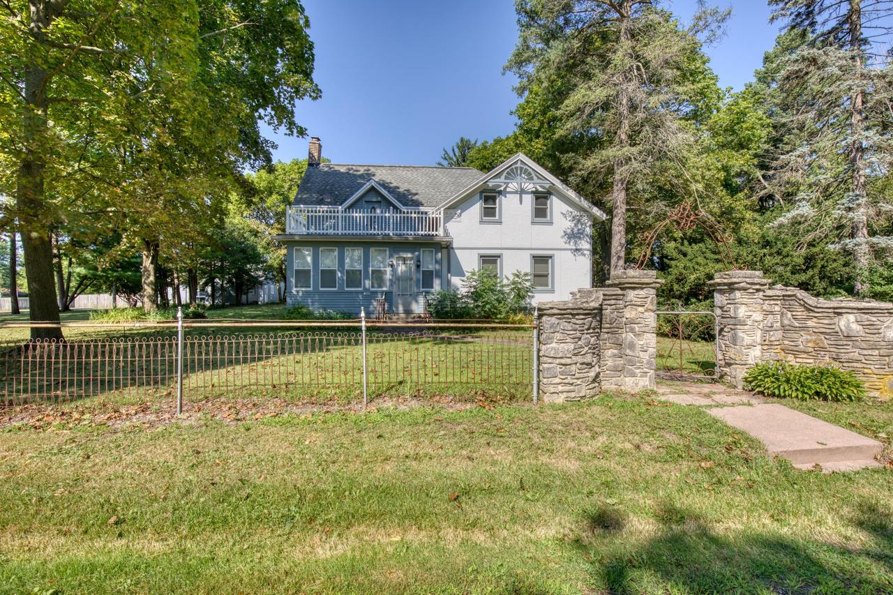 Escape to the country in this Hobby farm with endless possibilities in Richfield on 5.51 Acres. You will fall in love as soon as enter the lannon stone entry and iron fence.Over 3600 SF plus finished rec room. Lots of outbuilding for your toys 60'x22' outbuilding, 20''x50' Detached garage. unique flex space outbuilding for home office? Classic pump house. Covered porch with barn beams. Updates include; Newer septic 3yr's, Roof 10yr's. Home boasts some charm from the past with ornate plaster ceilings, coffered ceilings, with modern updates of granite counter tops, some new windows and doors, Bright remodeled sun room off kitchen, huge family room with NFP and a office/studio nook. Rec room in basement with fun bar includes commercial grade tapper, new full BAWelcome to your own estat