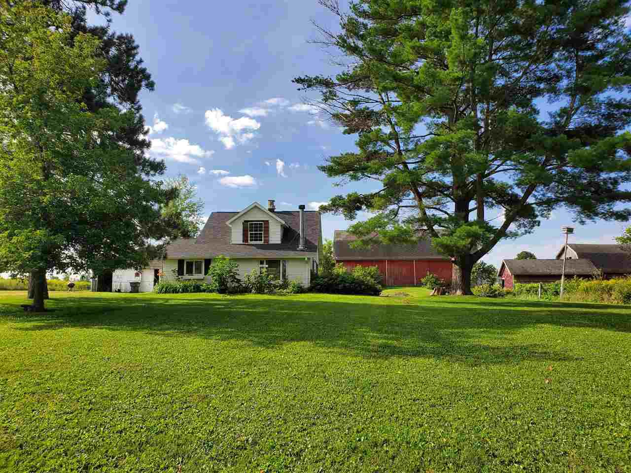 **MOTIVATED SELLER**FOR LAND?S SAKE! Check out this 4 BR 1 BA farmhouse set on 45.33 stunning acres just north of Stratford. This peaceful setting has it all! Home and buildings are situated on about 5 acres, 17-20 acres can be farmed or rented and over 15 wooded acres with a creek to harvest your own trophy deer! Step saver kitchen with plenty of natural light has a newer fridge, stove, and microwave. Private dining room with original hardwood floors and built-in hutch for your china. Large family room features wood-burning fireplace, refinished hardwood floors, and a french door that opens to a rear deck overlooking the property. Home also features main floor bedroom, bathroom, and mudroom with laundry. Upstairs you will find three additional bedrooms with nice closets and all with hardwood floors just waiting to be refinished! TLC and a few repairs are needed throughout the home but endless possibilities on a hard to find piece of property!,Additional features include mound system, newer roof on house, 200 amp, new water heater, and pressure tank. Interested in making your own maple syrup? Plenty of maples to tap to start your new hobby! Huge barn on property could be used to start up the hobby farm you?ve always wanted, goats, sheep, horses, you name it! Close to Big Rapids Park and centrally located between Marshfield and Wausau. Tax Pin: 020-2703-031-0994 020-2703-031-0992